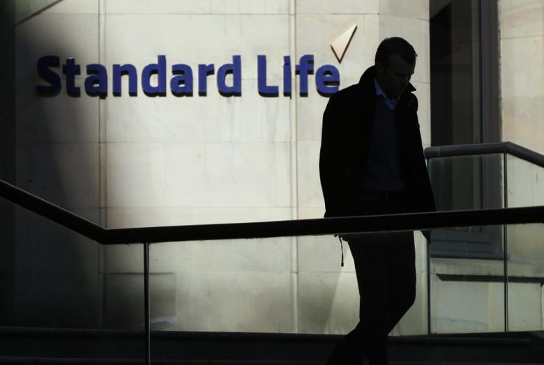 A worker leaves the Standard Life House in Edinburgh, Scotland February 27, 2014. REUTERS/Russell Cheyne