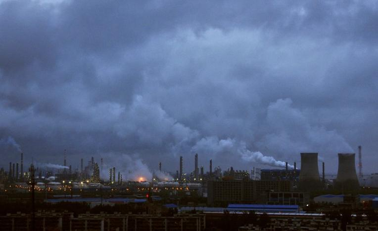 Smoke rises from chimneys and cooling towers of a refinery in Ningbo, Zhejiang province August 19, 2014. China Daily CHINA OUT. NO COMMERCIAL OR EDITORIAL SALES IN CHINA