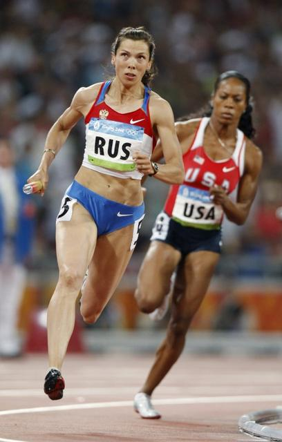 Three russian runners banned for four years after beijing for Lampen reuter