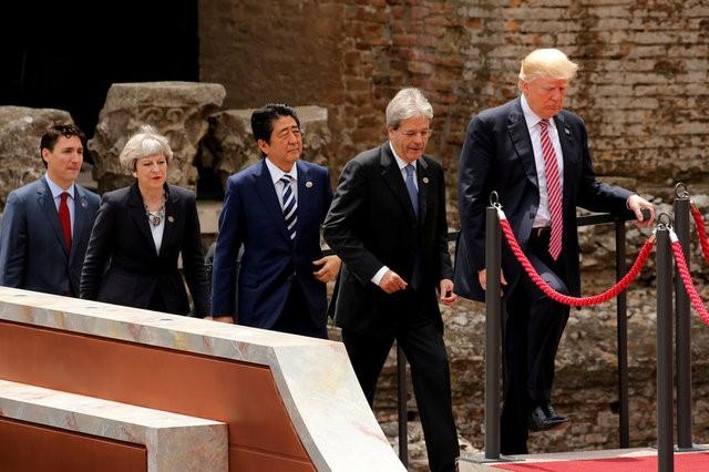From R-L, U.S. President Donald Trump, Italian Prime Minister Paolo Gentiloni, Japanese Prime Minister Shinzo Abe, Britain's Prime Minister Theresa May, Canadian Prime Minister Justin Trudeau arrive for a family photo at the G7 Summit in Taormina, Sicily, Italy, May 26, 2017. Jonathan Ernst