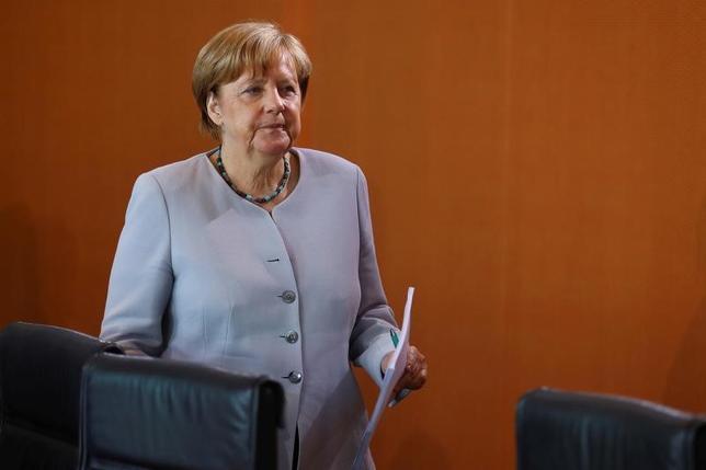 6月29日、ドイツのメルケル首相(写真)は、同国のハンブルクで開催される20カ国・地域(G20)首脳会議では温暖化対策が主要議題のひとつになると述べた。写真はベルリンで28日撮影(2017年 ロイター/Hannibal Hanschke)