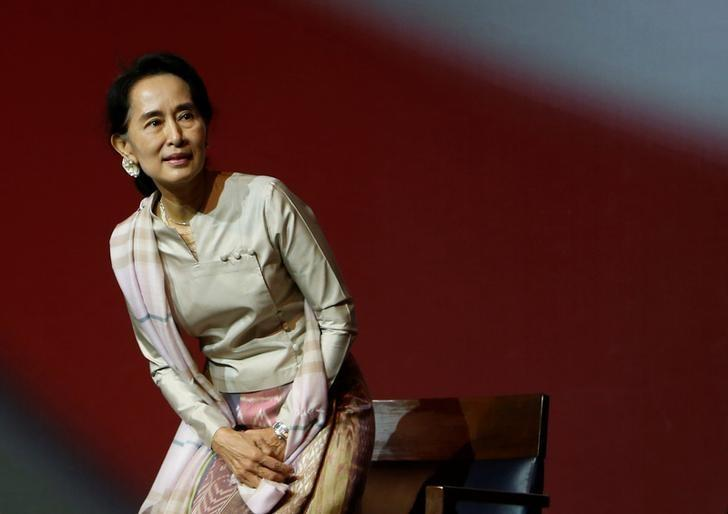FILE PHOTO: Myanmar's opposition leader Aung San Suu Kyi takes her seat as she waits to speak to the Myanmar community living in Singapore on the island of Sentosa in Singapore September 22, 2013.    REUTERS/Edgar Su/File Photo