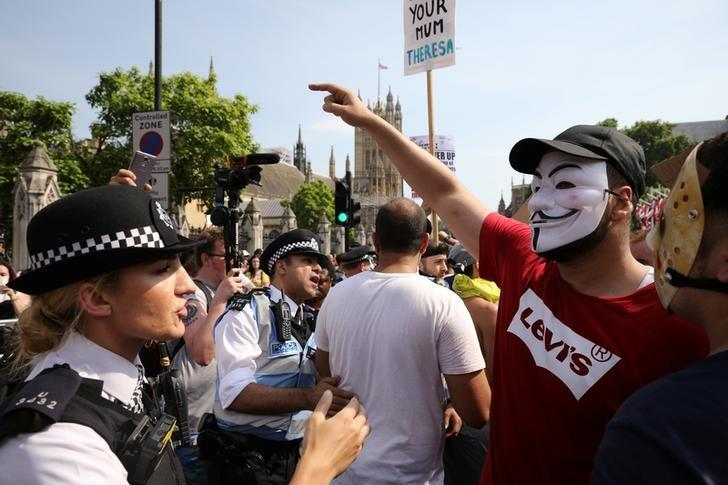 Demonstrators and police officers at a 'Day of Rage' protest after London's Grenfell Tower fire, June 21, 2017. Marko Djurica