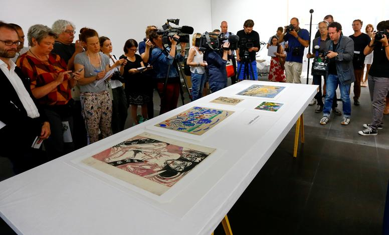 Media takes pictures during a news conference after the arrival of the first artworks from the Dossier Gurlitt in Bern, Switzerland July 7, 2017. Arnd Wiegmann