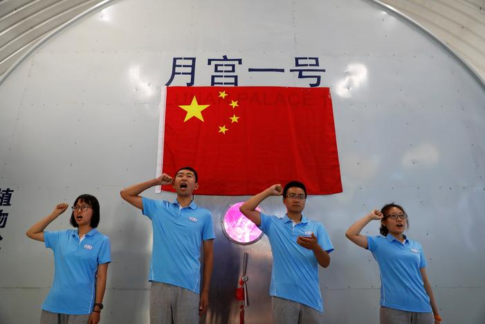 Volunteers take an oath before entering a simulated space cabin in which they will temporarily live as a part of the scientistic Lunar Palace 365 Project, at Beihang University in Beijing, China July 9, 2017. Damir Sagolj