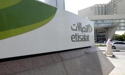 A man walks past a sign at the headquarters of telecommunications company Etisalat in Dubai, file.    REUTERS/Jumana El Heloueh
