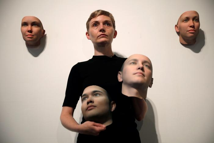Artist Heather Dewey-Hagborg poses with various 3-D printed masks created from DNA extracted from cheek swabs and hair clippings she received from formerly imprisoned U.S. Army Private Chelsea Manning while she was in jail, ahead of the August 2, 2017 opening of 'A Becoming Resemblance', an exhibition at the Fridman gallery in New York City, July 7, 2017. Mike Segar