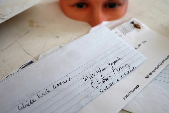 A hand written letter from formerly imprisoned U.S. Army Private Chelsea Manning while she was in jail sits on a table in the studio of Artist Heather Dewey-Hagborg where she created computer models for 3-D printed masks created from DNA extracted from cheek swabs and hair clippings she received from Manning, ahead of the August 2, 2017 opening of 'A Becoming Resemblance', an exhibition at the Fridman gallery in New York City, July 7, 2017. Mike Segar