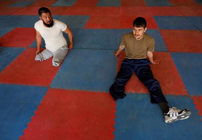 Salahuddin Zahiri 28, (R) and Abdul Hanan 34, (L) wounded members of Afghanistan's National Army (ANA) rest after exercising for the Invictus Games competition, at the Kabul Military Training Centre (KMTC) in Kabul, Afghanistan July 4, 2017. Mohammad Ismail