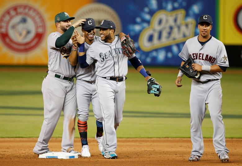 cceb3076064 American League players including Robinson Cano (22) of the Seattle  Mariners celebrate after defeating