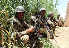 جنود أفغان في إقليم هلمند. أرشيف رويترز