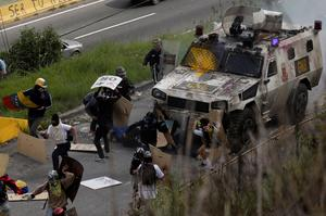 Armored vehicle hits Venezuelan protesters