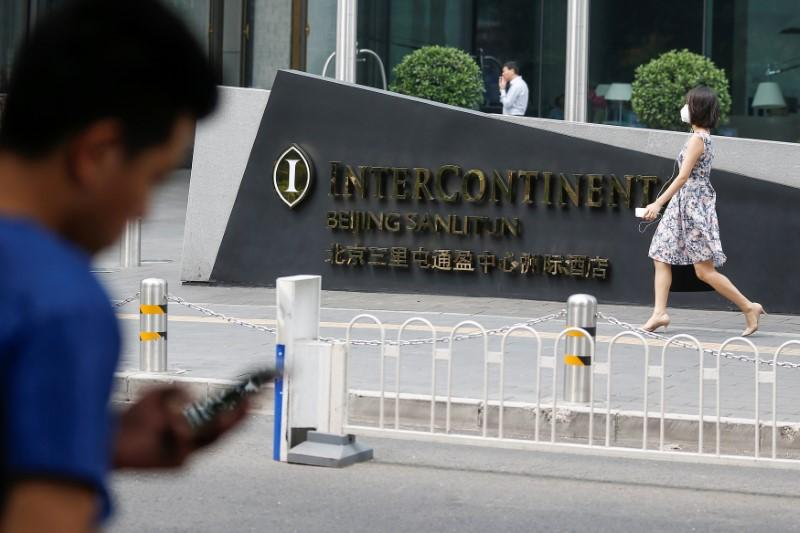 In China's hotel lobbies, small gaps in 'Great Firewall' are