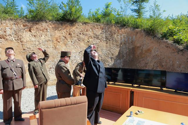 North Korean leader Kim Jong Un looks on during the test-launch of the intercontinental ballistic missile Hwasong-14. KCNA/via REUTERS