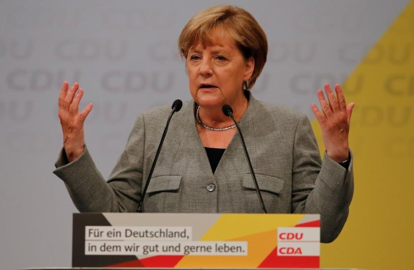 Merkel rejects electric car quota pushed by German election rival