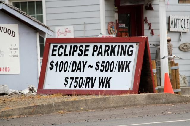 A parking sign for people visiting for the Solar Eclipse is shown in Depoe Bay, Oregon, U.S. August 9, 2017. Picture taken August 9, 2017.  REUTERS/Jane Ross