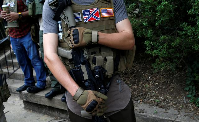 A member of a militia stands near a rally in Charlottesville. REUTERS/Joshua Roberts