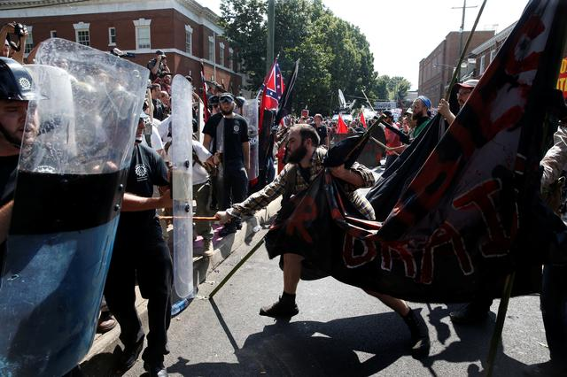 White nationalists clash against a group of counter-protesters in Charlottesville. REUTERS/Joshua Roberts
