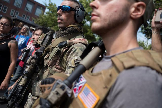 Member of a militia stands near a rally in Charlottesville. REUTERS/Justin Ide