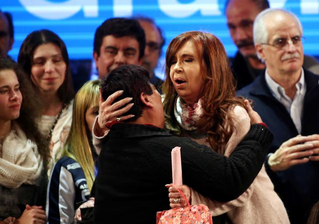 Cristina Fernandez de Kirchner, former Argentine President and candidate for the Senate in the mid-term primary elections, embraces a supporter after her speech at her campaign headquarters in Buenos Aires, Argentina early August 14, 2017.  REUTERS/Marcos Brindicci