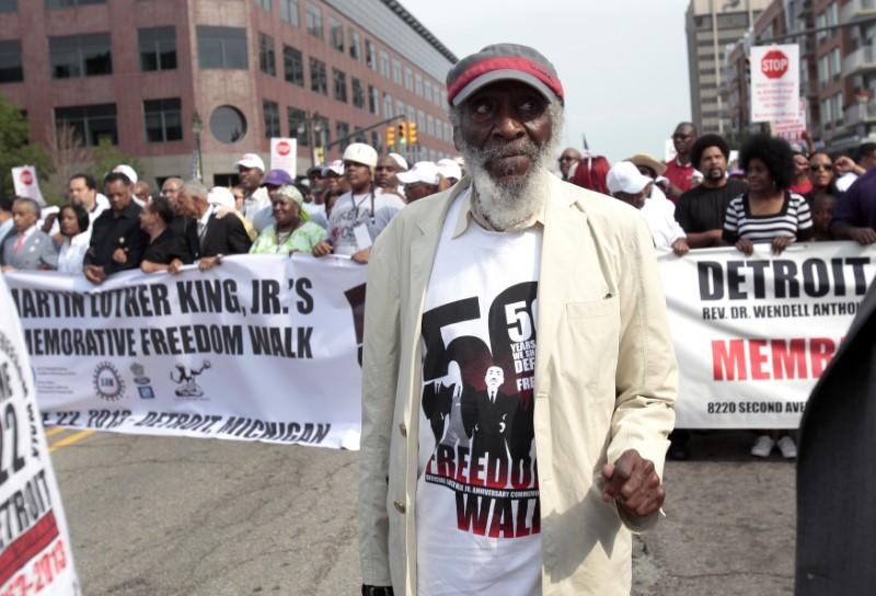 FILE PHOTO: Comedian and social activist Dick Gregory marches down Woodward Avenue during the 50th Anniversary Commemorative Freedom Walk in Detroit, ...