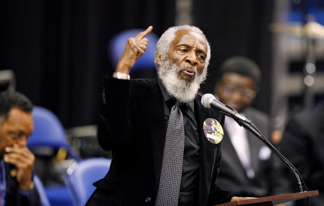 FILE PHOTO - Activist Dick Gregory delivers a speech during a public viewing and funeral for legendary singer James Brown in Augusta, Georgia December 30, ...