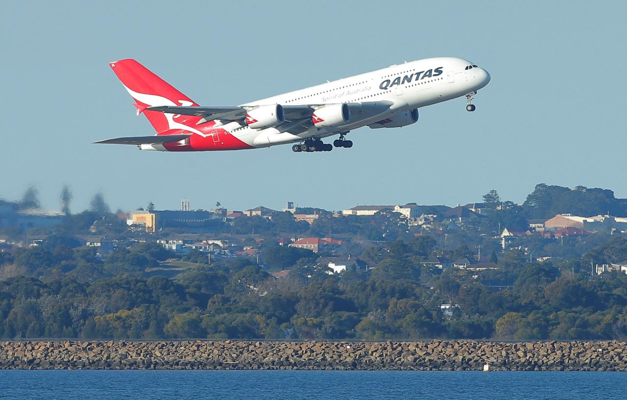 Australias qantas firms up plans for worlds longest commercial qantas flight qf1 an a380 aircraft takes off from sydney international airport en route to dubai above botany bay in australia august 22 2017 stopboris Choice Image
