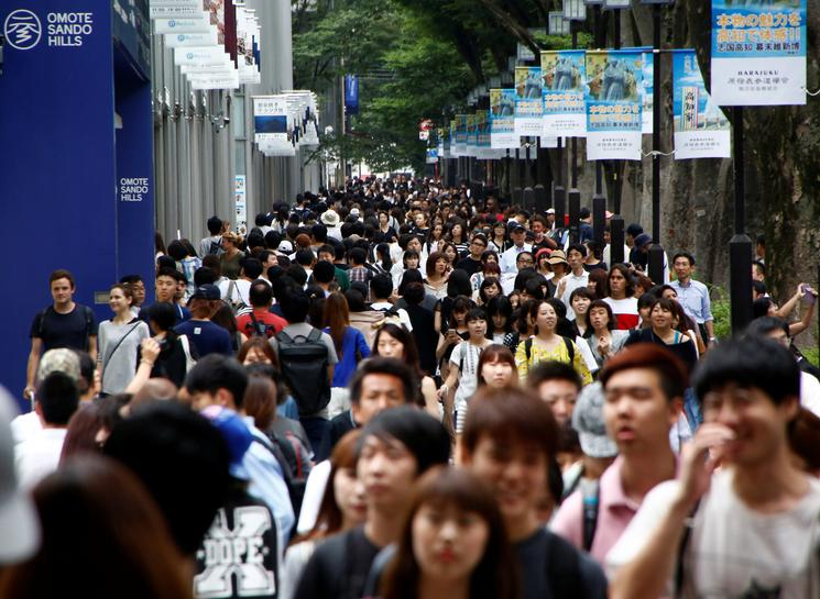 Japan spending falls but tight jobs market offers hope of end to deflation