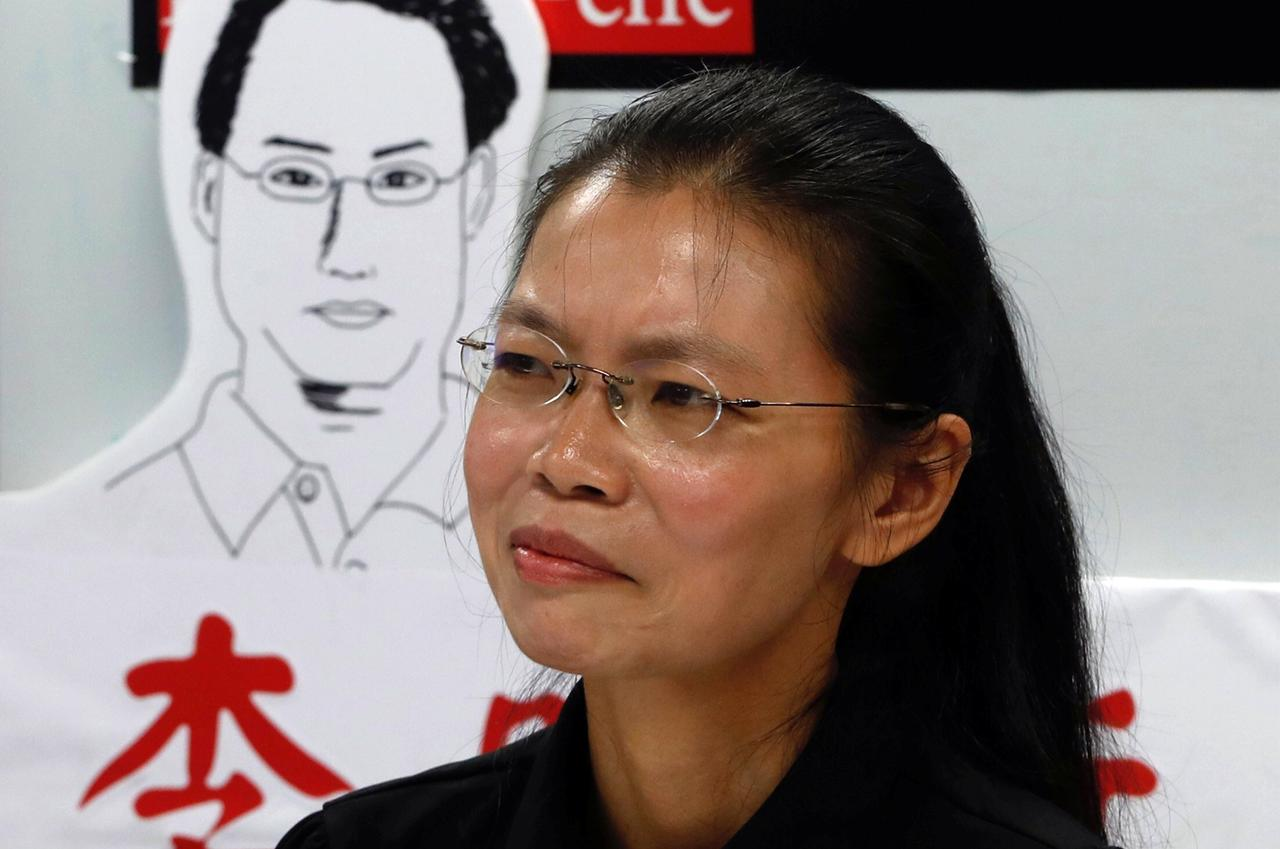 Lee Ching-yu, wife of Taiwan human rights advocate Lee Ming-che, who has been detained in China, speaks to the media a day before departing for her ...