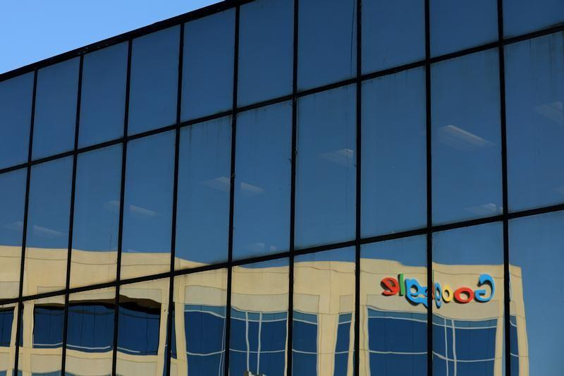 The Google logo is shown reflected on an adjacent office building in Irvine, California, U.S. August 7, 2017.   Mike Blake
