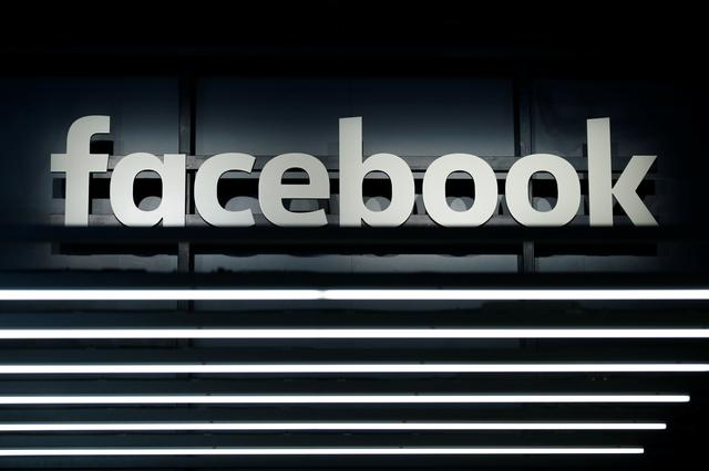 FILE PHOTO: A Facebook logo is pictured at the Frankfurt Motor Show (IAA) in Frankfurt, Germany September 16, 2017. REUTERS/Ralph Orlowski