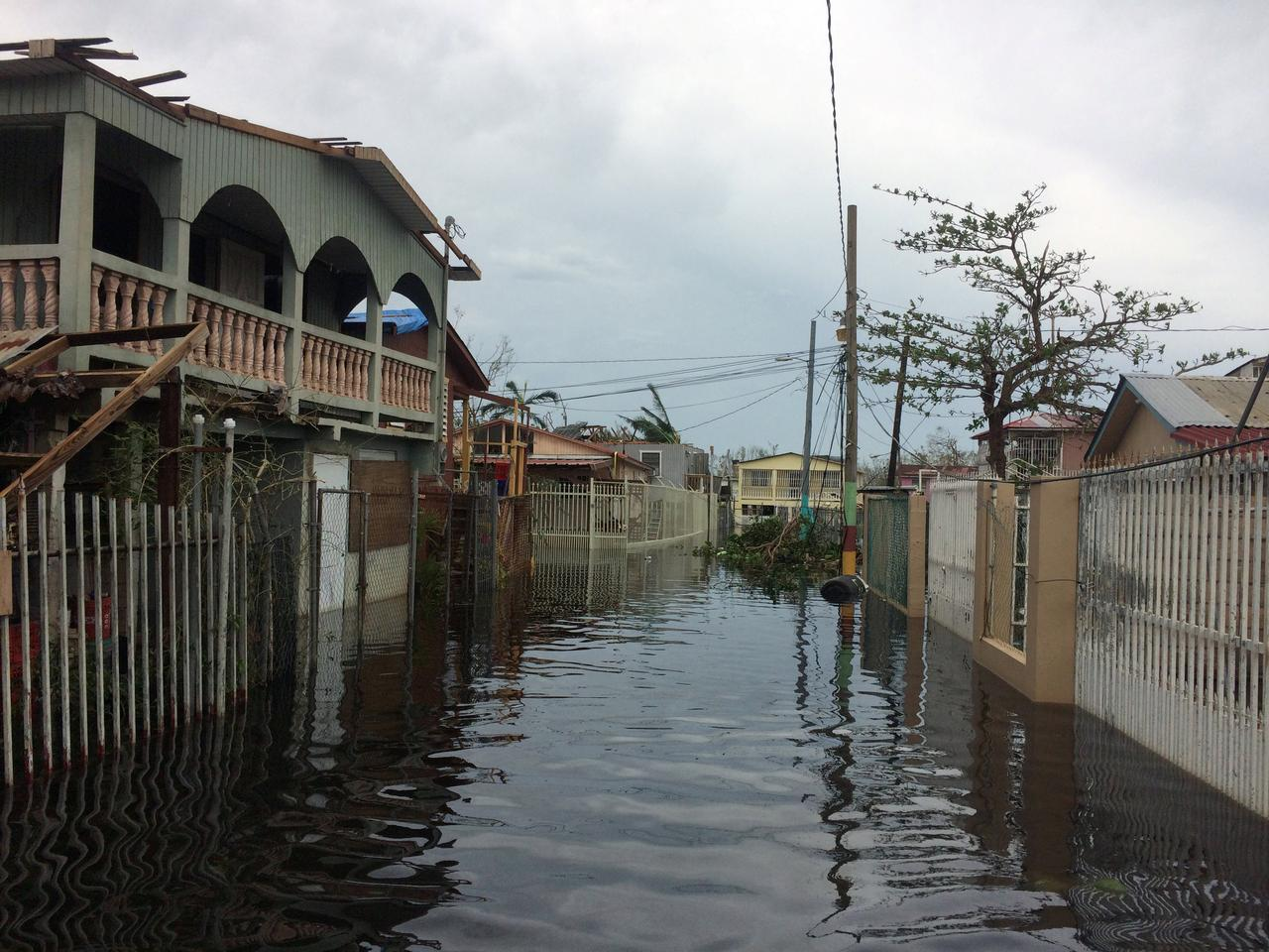 A flooded street is seen in the Juana Matos neighbourhood in Catano municipality after Hurricane Maria, southwest of San Juan, Puerto Rico September 21, ...