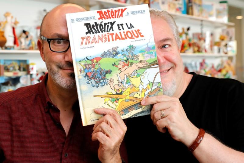 Author Jean-Yves Ferri (L) and illustrator Didier Conrad (R) pose with a copy of their new comic album