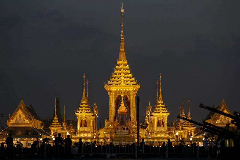 Sea of black in Bangkok as thousands flock to late king's