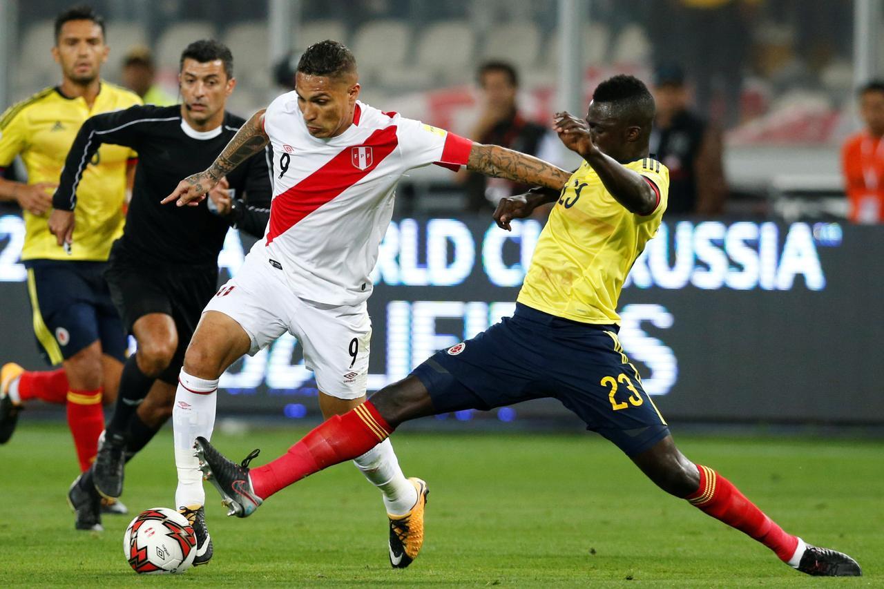 2bcc3f410 Peru s Paolo Guerrero and Colombia s Davinson Sanchez in action.  REUTERS Mariana Bazo