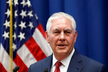 FILE PHOTO: U.S. Secretary of State Rex Tillerson speaks to staff members...