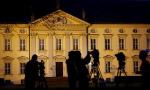 Members of the media are seen in front of the presidential Bellevue Palace...