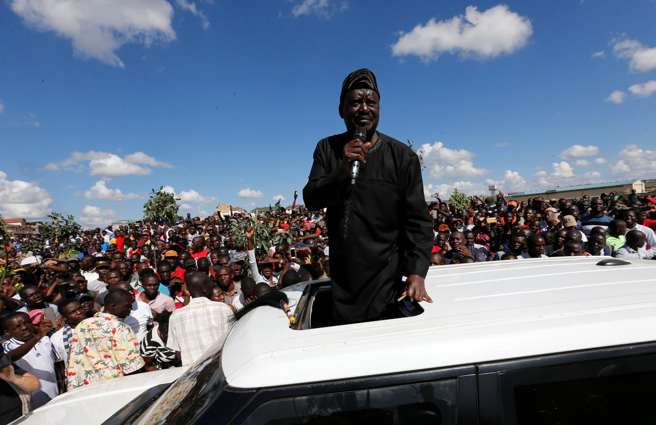 Image result for Kenyan opposition leader of the National Super Alliance (NASA) coalition Raila Odinga addresses his supporters as he leads a commemoration of the lives of his supporters killed during confrontations with the security forces over the election period, in Nairobi, Kenya November 28, 2017. REUTERS/Thomas Mukoya