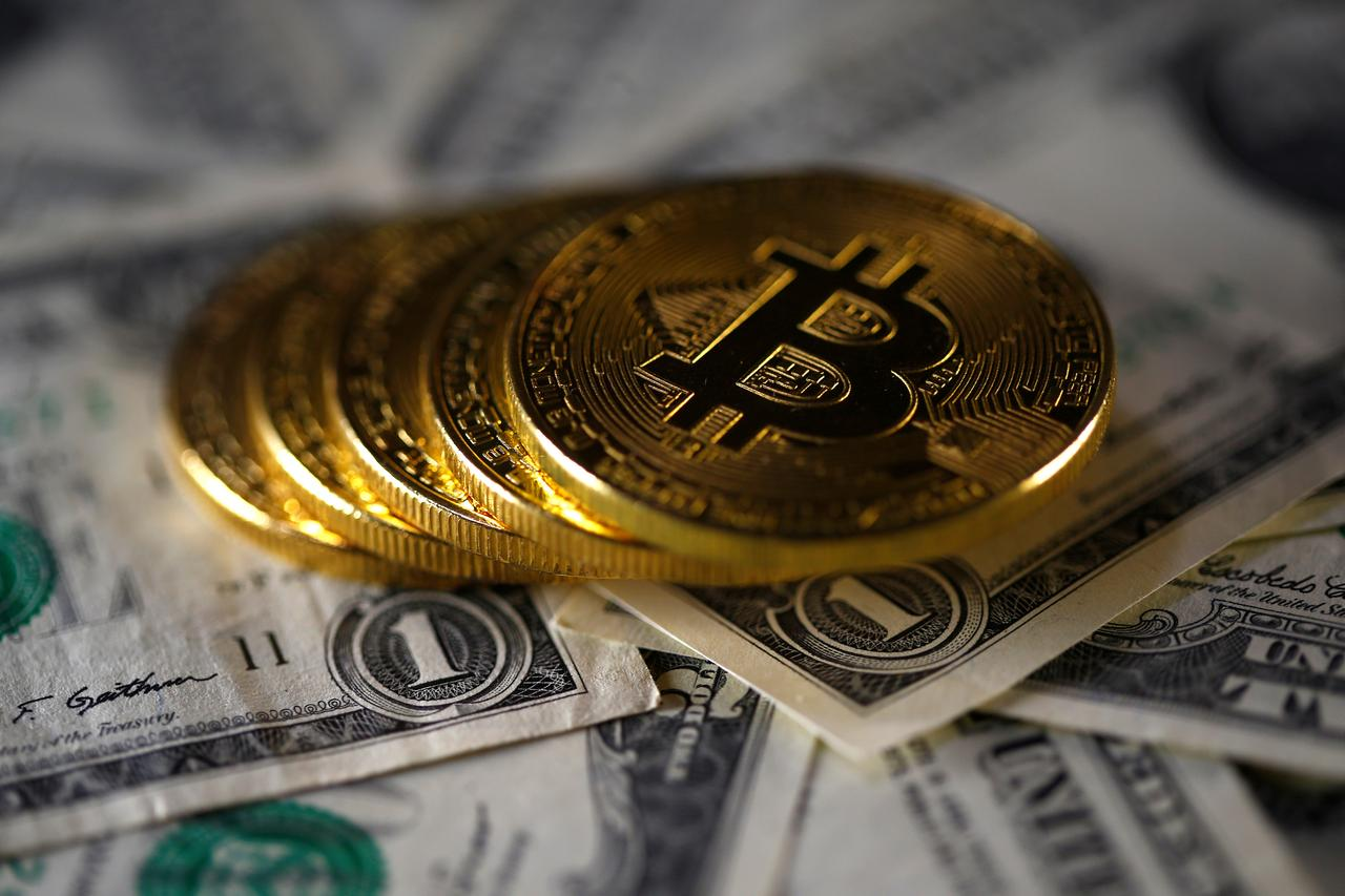 Cboe beats cme to bitcoin futures launch with dec 10 start bitcoin virtual currency coins placed on dollar banknotes are seen in this illustration picture november 6 2017 reutersdado ruvicillustration biocorpaavc Choice Image