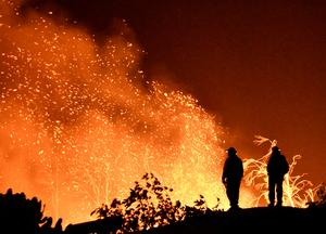 California battles historic wildfire