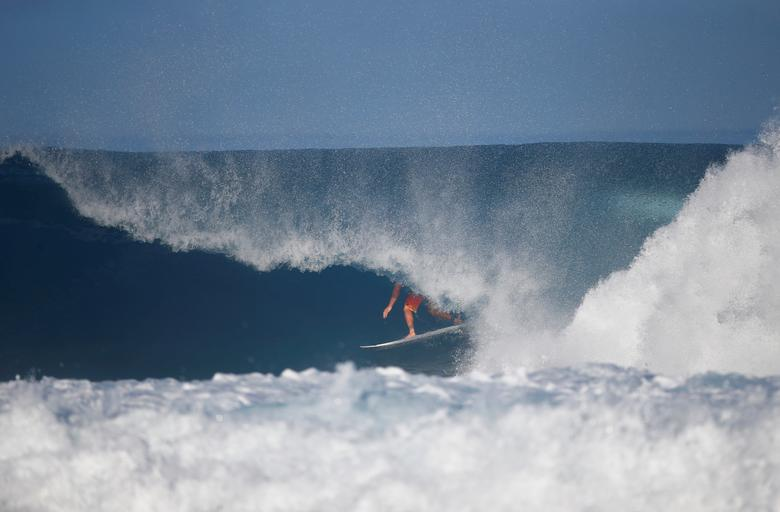 17e16430fe0fbc Surfer Joel Parkinson competes during the Billabong Pipe Masters at the  Banzai Pipeline in Pupukea on