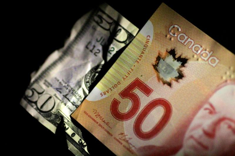 File Photo U S And Canada Dollar Notes Are Seen In This June 22 2017 Ilration Reuters Thomas White