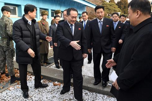 North and South Korea hold rare talks