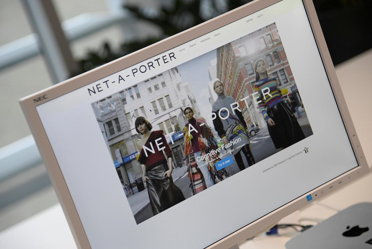623282f7b79e5 FILE PHOTO  A web page for online clothing retailer Yoox Net-A-Porter is  seen at their Tech Hub premises in White City in London