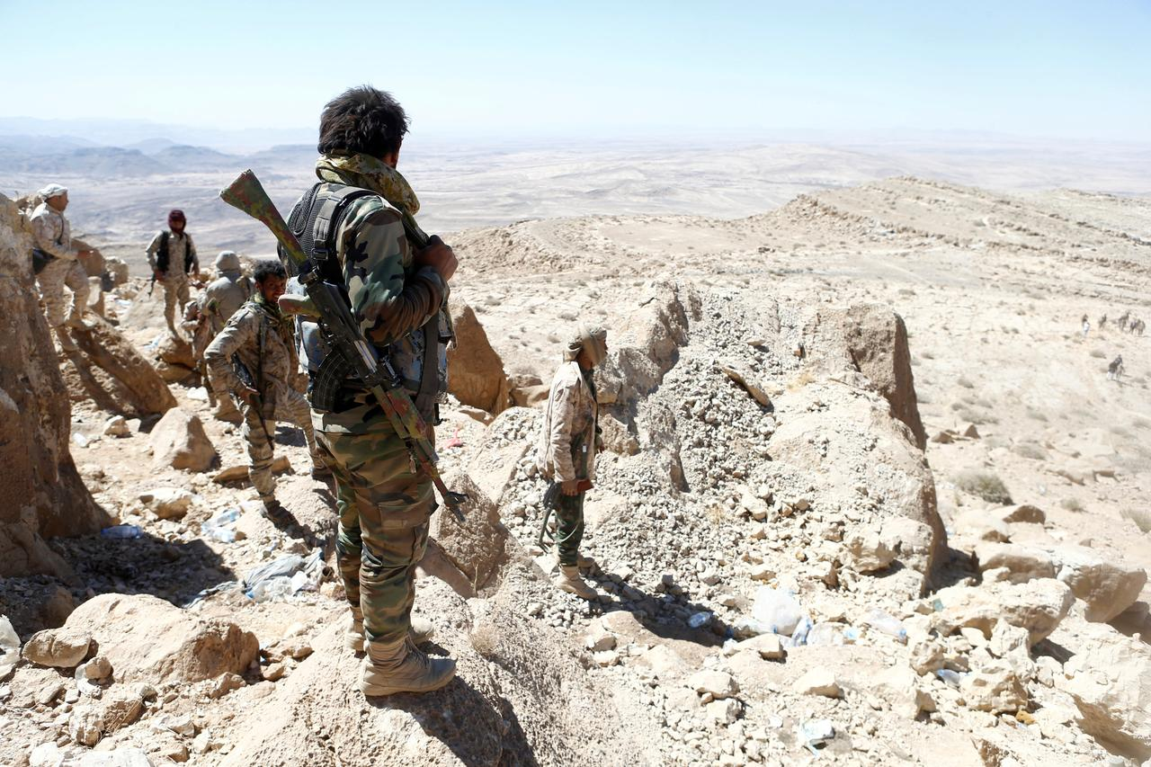 Yemeni soldiers stand on their position on a mountain on the frontline of fighting with Houthis in Nihem area, near Sanaa, Yemen January 27, 2018.
