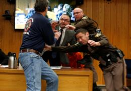 Father of victims lunges at Nassar