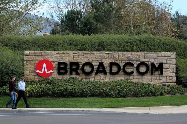 FILE PHOTO: A sign to the campus offices of chip maker Broadcom Ltd, who announced on Monday an unsolicited bid to buy peer Qualcomm Inc for $103 billion, is shown in Irvine, California, U.S., November 6, 2017.     REUTERS/Mike Blake/File Photo