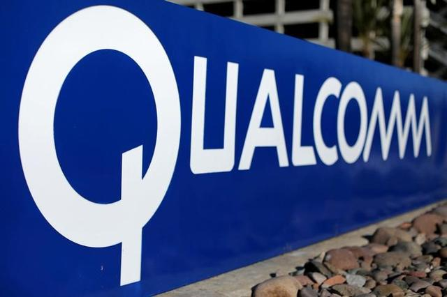 FILE PHOTO: A sign on the Qualcomm campus is seen, as chip maker Broadcom Ltd announced an unsolicited bid to buy peer Qualcomm Inc for $103 billion, in San Diego, California, U.S. November 6, 2017. REUTERS/Mike Blake/File Photo
