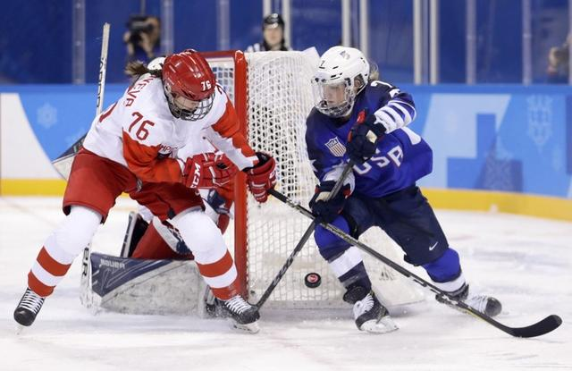 Ice Hockey – Pyeongchang 2018 Winter Olympics – Women Preliminary Round Match - U.S. v Olympic Athletes from Russia - Kwandong Hockey Centre, Gangneung, South Korea – February 13, 2018 -Yekaterina Nikolayeva, an Olympic athlete from Russia, in action with Monique Lamoureux-Morando of the U.S.. REUTERS/David W Cerny