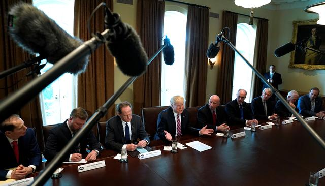 U.S. President Donald Trump holds a meeting on trade with members of Congress at the White House in Washington, U.S., February 13, 2018. REUTERS/Kevin Lamarque